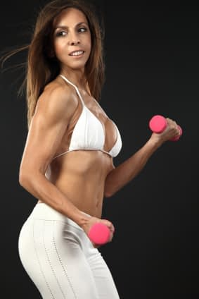 Do you think this woman build those arms and shoulders with those stupid little pink dumbbells?